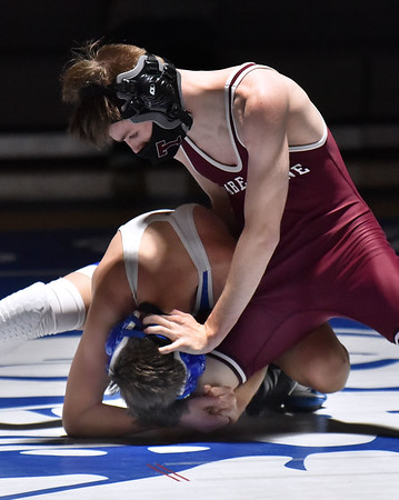CARL RUSSO/staff photo Timberlane's TJ Labatte defeats Salem's Brody McDonald in the 106 pound match. Timberlane at Salem in wrestling action. 2/3/2021