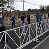 "TIM JEAN/Staff photo<br /> <br /> The next wave of runners line up in the corral area during the annual New Year's Day Millennium Mile Road Race in Londonderry, NH. The race featured a ""time trial start"" format that maintained social distancing for the runners.     1/1/21"