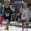 TIM JEAN/Staff photo<br /> <br /> Sam Lanternier, 23, of Dover, and Everett Hackett, 30, of Hartford CT., make there way along the corse during the annual New Year's Day Millennium Mile Road Race in Londonderry, NH.      1/1/21