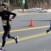 TIM JEAN/Staff photo<br /> <br /> Summer Cook, 43, left, and her daughter Madelyn Cook, 11, both of Madbury NH., run along the corse during the annual New Year's Day Millennium Mile Road Race in Londonderry, NH.      1/1/21