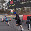 TIM JEAN/Staff photo<br /> <br /> Connor Herzon, 7, left, and his father Noah Herzon, 39, both of Londonderry, leave the starting line during the annual New Year's Day Millennium Mile Road Race in Londonderry, NH.      1/1/21