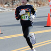 TIM JEAN/Staff photo<br /> <br /> Kyla Breslin, 11, of Lowell, MA., makes her way along the corse during the annual New Year's Day Millennium Mile Road Race in Londonderry, NH.      1/1/21