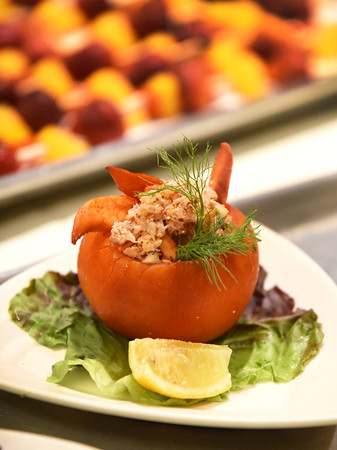 BRYAN EATON/Staff photo. Director of Culinary Services at Atria Marland Place,  Jim Arhelger's lobster-stuffed tomato, with lightly sauteed shallots, fennel, lemon zest using beefsteak tomatoes.