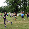 RYAN HUTTON/ Staff photo<br /> Participants in an outdoor fitness class on the North Andover Town Common warm up with some Zumba on Tuesday evening.