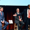 CARL RUSSO/staff photo. Republican candidates running for New Hampshire's 1st Congressional District debated Wednesday night at the Stockbridge Theater at Pinkerton Academy in Derry. Chief Eddie Edwards, of Dover, a former South Hampton police chief and state liquor enforcement officer gestures to and comments on a statement New Hampshire State Senator, Andy Sanborn, left, of Bedford made as Bruce Crochetiere, a tech entrepreneur from Hampton Falls listens. The debate is sponsored by the Rockingham County Republican Committee. 7/11/2018