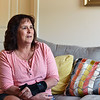 RYAN HUTTON/ Staff photo<br /> Sitting in her Methuen home, Bernadette Coughlin reflects on how she was fired by Sodexo, a food contractor for Holy Family Hospital, after she tested positive for marijuana following a workplace fall. Coughlin says she occasionally uses marijuana since it has been legalized in the state but has never been under the influence at work.