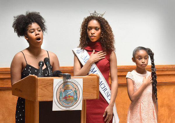 BRYAN EATON/Staff photo. Family friend, Briannette, Villa, 17, sings the National Anthem with Miss Massachusetts, Gabriela Taveras, and Lyahnette Morales, Miss Mayflower Princess 2018 who received recognition from Mayor Daniel Rivera.