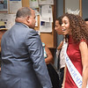 BRYAN EATON/Staff photo. Gabriela Taveras meets Lawrence Mayor Daniel Rivera and others before the ceremony.