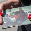 AMANDA SABGA/Staff photo<br /> <br /> Kaleigh Sekendorf holds a photo of  her father's beloved red Ford truck parked at the fire station. After inheriting it when her father passed away, Sekendorf lost it due to finances and being reunited with it after the kind gesture of a stranger who heard her story.<br /> <br /> 7/13/18
