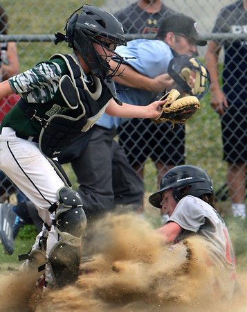 CARL RUSSO/staff photo. North Andover's Mikey Sullivan slides hard into home plate to score as Billerica's catcher, Tyler Killilen tries to make the tag. The North Andover American Little League team was defeated by Billerica 4-3 in District 14 best-of-3 finals. The teams will play the second game on Thursday night in Billerica. 7/10/20188