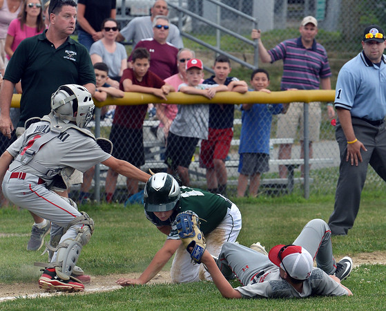 CARL RUSSO/staff photo. North Andover's catcher Zach Wolinski makes the tag on Billerica's Jake Zawatsky who goes down along with North Andover third baseman Cole Mullen. Zawatsky was caught on the third base line trying to go home. The North Andover American Little League team was defeated by Billerica 4-3 in District 14 best-of-3 finals. The teams will play the second game on Thursday night in Billerica. 7/10/2018