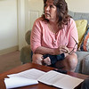 RYAN HUTTON/ Staff photo<br /> Bernadette Coughlin looks over the paperwork associated with her firing from Sodexo, a food contractor for Holy Family Hospital, after she tested positive for marijuana following a workplace fall. Coughlin says she occasionally uses marijuana since it has been legalized in the state but has never been under the influence at work.