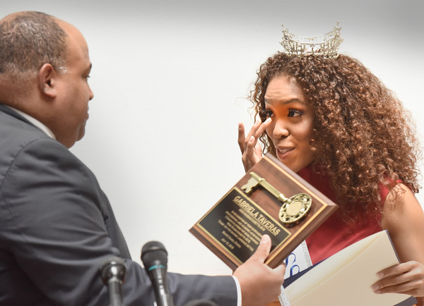 BRYAN EATON/Staff photo. Gabriela Taveras wipes a tear as she receives her key to the City of Lawrence from Mayor Daniel Rivera.