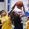 CARL RUSSO/Staff photo Haverhill's Kya Burdier, left defends as North Andover's Maeve Gaffny drives to the hoop. North Andover defeated Haverhill 52-34 in Girls Basketball Summer League played at Methuen high school. 7/21/2021
