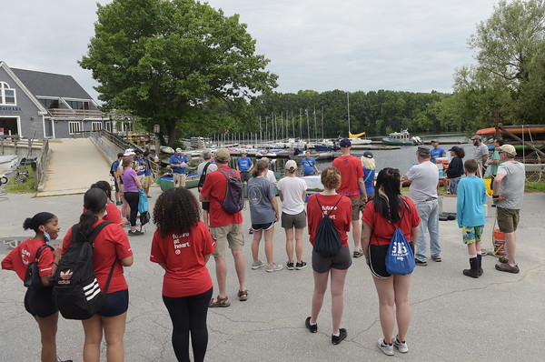 TIM JEAN/Staff photo<br /> <br /> Dozens of volunteers listen to boat safety instructions before heading out onto the river during a paddling and trash removal event on the banks of the Merrimack River. The event was organized by the Merrimack River Watershed Council and the Greater Lawrence Community Boating Program that offered participants a chance to clean up while on the Merrimack River around the Abe Bashara Boathouse in Lawrence.   7/17/21