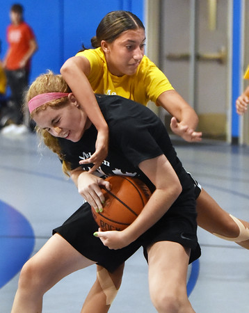 CARL RUSSO/Staff photo Haverhill's Alexsia Deoliveira, top and North Andover's Sarah von Sneidern fight for the ball. North Andover defeated Haverhill 52-34 in Girls Basketball Summer League played at Methuen high school. 7/21/2021