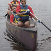 TIM JEAN/Staff photo<br /> <br /> After picking up debris Emily Rodriguez, front, Carlos Cabrea, and Lues Dubois, in back, all of Lawrence, maneuver their canoe back towards land during a paddling and trash removal event on the banks of the Merrimack River. The event was organized by the Merrimack River Watershed Council and the Greater Lawrence Community Boating Program that offered participants a chance to clean up while on the Merrimack River around the Abe Bashara Boathouse in Lawrence.   7/17/21