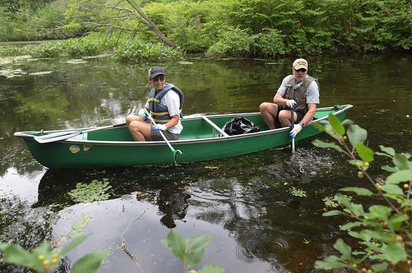 TIM JEAN/Staff photo<br /> <br /> Linda Cadran, left, of Merrimac and Thomas Haddad of Manchester, NH., maneuver in a canoe into an inlet during a paddling and trash removal event on the banks of the Merrimack River in Lawrence. The event was organized by the Merrimack River Watershed Council and the Greater Lawrence Community Boating Program that offered participants a chance to clean up while on the Merrimack River around the Abe Bashara Boathouse using a canoe.   7/17/21