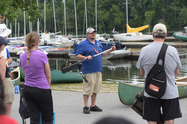 TIM JEAN/Staff photo<br /> <br /> Jed Koehler, Executive Director of the Greater Lawrence Community Boating Program gives boat safety instructions and paddling tips before volunteers get into canoes during a paddling and trash removal event on the banks of the Merrimack River. The event was organized by the Merrimack River Watershed Council and the Greater Lawrence Community Boating Program that offered participants a chance to clean up while on the Merrimack River around the Abe Bashara Boathouse in Lawrence.   7/17/21