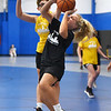 CARL RUSSO/Staff photo North Andover's Janie Papell drives to the hoop as Haverhill's Kya Burdier defends. North Andover defeated Haverhill 52-34 in Girls Basketball Summer League played at Methuen high school. 7/21/2021