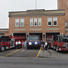 TIM JEAN/Staff photo<br /> <br /> Haverhill Fire Chief Bob O'Brien, Mayor James Fiorentini and several City Councilors pose for a photo in front of three new fire vehicles outside at the Water Street fire station.  7/1/21