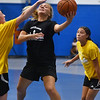 CARL RUSSO/Staff photo North Andover's Janie Papell drives to the hoop. North Andover defeated Haverhill 52-34 in Girls Basketball Summer League played at Methuen high school. 7/21/2021