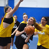 CARL RUSSO/Staff photo Haverhill's Haley Phillips, left defends as North Andover's Katie Robie fights her way to the hoop. North Andover defeated Haverhill 52-34 in Girls Basketball Summer League played at Methuen high school. 7/21/2021