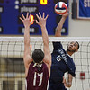 RYAN HUTTON/ Staff photo<br /> Lawrence High's Andre Wilson leaps to spike the ball during Wednesday's Division 1 North final game against Chelmsford at Tewksbury High.