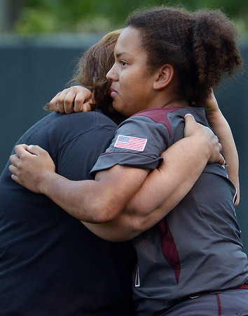CARL RUSSO/Staff photo. Whittier's head coach, Cheryl Begin hugs one of her four senior players, Kale Hobbs after the game. Whittier Tech was defeated 10-2 by North Reading in Div. 2 North softball semifinals. 6/13/2018