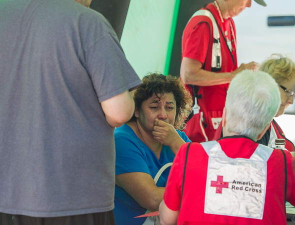 AMANDA SABGA/Staff photo<br /> <br /> Marilu Cano, 53 of Salem, talks with the Red Cross after a three alarm fire destroyed her home of six years at 80 Main Street in Salem leaving 17 people displaced and destroyed both the China Star restaurant and Venue Vapors.<br /> <br /> 6/13/18