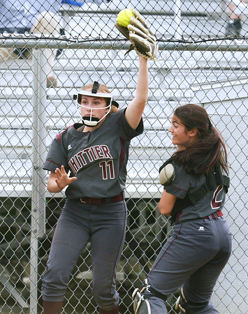 CARL RUSSO/Staff photo. Whittier's senior player, Kaley Thibault makes the out of bounds catch for the out as her senior catcher, Jacklyn Verrette backs her up. Whittier Tech was defeated 10-2 by North Reading in Div. 2 North softball semifinals. 6/13/2018