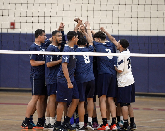 RYAN HUTTON/ Staff photo<br /> The Lawrence High boys volleyball team raises the hands in unity before the start of Wednesday's Division 1 North final game against Chelmsford at Tewksbury High.