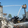 AMANDA SABGA/Staff photo<br /> <br /> Salem firefighters work the tail end of a three alarm fire at 80 Main Street in Salem that left 17 people displaced and destroyed both the China Star restaurant and Venue Vapors.<br /> <br /> 6/13/18