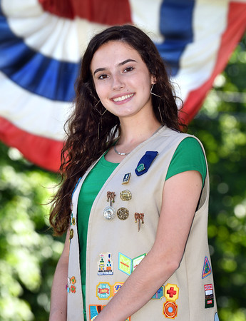 CARL RUSSO/Staff photo. Atkinson Girl Scout Audrey Latino, 18, troop 22726 is creating a project called the Look Up Atkinson Treasure Hunt with the help of the town's Kimball Library. The completion of her project will allow her to receive the Girl Scout's Gold Award, which is equivalent to the Boy Scout's Eagle Scout badge.   Latino is a 2019 graduate of Presentation of Mary Academy in Methuen and will attend the University of Connecticut in the fall. 6/24/2019