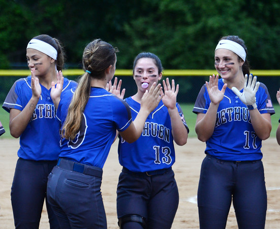 CARL RUSSO/staff photo Methuen's Makenna Donovan greets her teammates as the players  are introduced.  Methuen defeated Bridgewater-Raynham 6-2 in state semifinals softball action Wednesday night. 6/19/2019