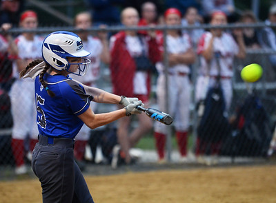 CARL RUSSO/staff photo Methuen's Claudie Crowe swings hard for a base hit early in the game.    Methuen defeated Bridgewater-Raynham 6-2 in state semifinals softball action Wednesday night.  6/19/201