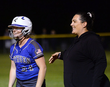 CARL RUSSO/staff photo Methuen's senior captain, Emma McAlpine and assistant coach Jackie Rubino are all smiles at first base after McAlpine got a base hit.  Methuen defeated Bridgewater-Raynham 6-2 in state semifinals softball action Wednesday night. 6/19/2019