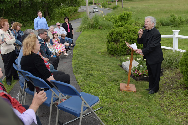 TIM JEAN/Staff photo  Father Gino Marchesani, right, speaks during a dedication ceremony for the marking of the former site of Don Orione Fathers Seminary, a Summer Camp for Children and Residential Home for the Intellectually Disabled in Haverhill.      6/21/19