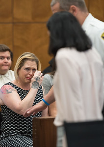 AMANDA SABGA/Staff photo  Caitlyn Schelling, mother of Alexis Spartz, reacts as Emily McGovern, 20, of Methuen is escorted out following her arraignment at Haverhill District Court, on several charges including manslaughter. On March 31, 2018 McGovern was driving at a recorded 107 miles per hour when her car crashed on I-495 in haverhill resulting in the death of her passenger Alexis Spartz, 18.   6/21/19