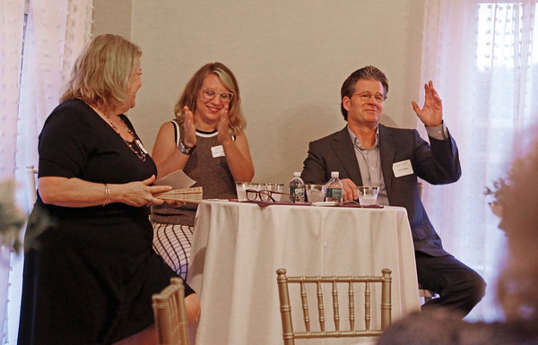 """MIKE SPRINGER/Staff photo Novelist Andre Dubus III, right, speaks in a panel discussion on domestic violence with his sister Suzanne Dubus, left, CEO of the Jeanne Geiger Crisis Center, and writer Rachel Louise Snyder, author of """"No Visible Bruises: What We Don't Know About Domestic Violence Can Kill Us,"""" during an event Thursday at the home of Elias and Karine Nabbout in Andover. 6/20/2019"""