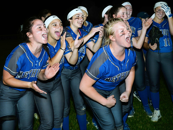 CARL RUSSO/staff photo Methuen's senior captain, Emma McAlpine, front leads the celebration along with, rear from left, Avry Nelson, Dana Littlefield and Stephanie Tardugno.   Methuen defeated Bridgewater-Raynham 6-2 in state semifinals softball action Wednesday night.  6/19/2019