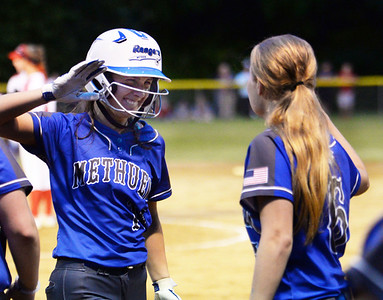 CARL RUSSO/staff photo Methuen's senior captain and first baseman Cori Rizzo, left, celebrates with Isabel Putnam after Rizzo hit a home run.   Methuen defeated Bridgewater-Raynham 6-2 in state semifinals softball action Wednesday night. 6/19/2019