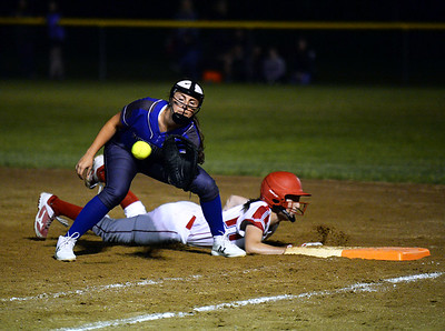 CARL RUSSO/staff photo Methuen's senior captain and first baseman, Cori Rizzo attempts to pick off a runner on first.    Methuen defeated Bridgewater-Raynham 6-2 in state semifinals softball action Wednesday night. 6/19/2019