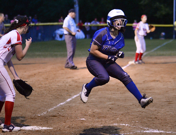 CARL RUSSO/staff photo Methuen's Stephanie Tardugno leaps in celebration after crossing home plate to score the first run for Methuen.   Methuen defeated Bridgewater-Raynham 6-2 in state semifinals softball action Wednesday night.  6/19/201