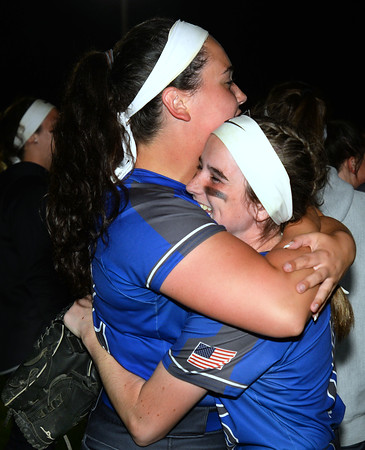 CARL RUSSO/staff photo Methuen's starting pitcher Jillian McCoy, left, hugs Claudia Crowe as they celebrate  the victory.   Methuen defeated Bridgewater-Raynham 6-2 in state semifinals softball action Wednesday night. 6/19/2019