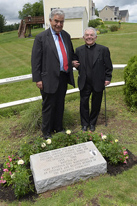 TIM JEAN/Staff photo  Mayor James Fiorentini, left, poses for a photograph with Father Gino Marchesani, after a dedication ceremony for the marking of the former site of Don Orione Fathers Seminary, a Summer Camp for Children and Residential Home for the Intellectually Disabled in Haverhill.      6/21/19