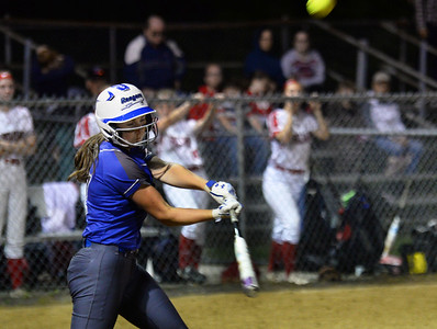 CARL RUSSO/staff photo Methuen's senior captain and first baseman, Cori Rizzo swings hard on this pitch late in the game. She hit a home run early in the game.   Methuen defeated Bridgewater-Raynham 6-2 in state semifinals softball action Wednesday night. 6/19/2019