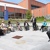 TIM JEAN/Staff photo<br /> <br /> In center, Lane Glenn, President Northern Essex Community College speaks during a round table discussion with U.S. Senator Elizabeth Warren, outside at the Lawrence campus.   6/1/21