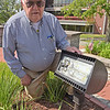 TIM JEAN/Staff photo<br /> <br /> Russell Chaput, 89, of Haverhill, shows the damage to one of the LED flood lights around the Korean War Veterans Memorial in GAR Park, Haverhill. The local Korean War Veterans, not the city, pay for all the maintenance and upkeep of the memorial. The hope to raise about $500 to replace the light.     6/2/21