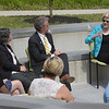 TIM JEAN/Staff photo<br /> <br /> U.S. Senator Elizabeth Warren, right, talks during a round table discussion with students and staff of Northern Essex Community College outside at the Lawrence campus. Seated at left if Lane Glenn, President of the collage. 6/1/21